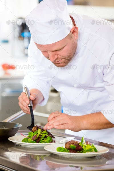 Chef prepares steak dish at gourmet restaurant