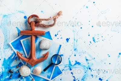Copy space travel background with wooden anchor and magnifying glass