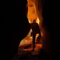 Underground cave passage with a caver
