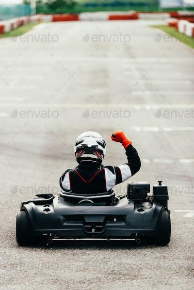 Woman driving go-cart