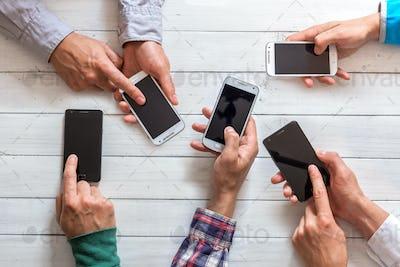 Mobile phones in friends hand