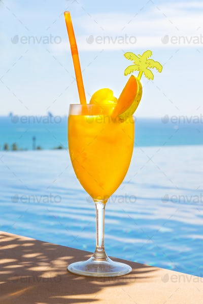Fresh Mango Juice In Glass At Poolside