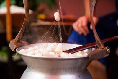 Silk Cocoons Boiling In Large Pot