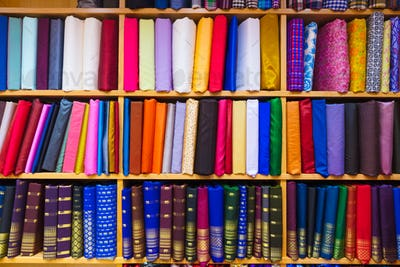 Colorful Fabrics Displayed In Shelves At Store