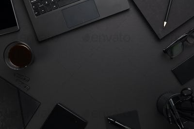 Laptop and Office Supplies At Dark Gray Desk