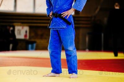 athlete judoka in blue kimono