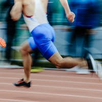 blurred motion man runners sprinters