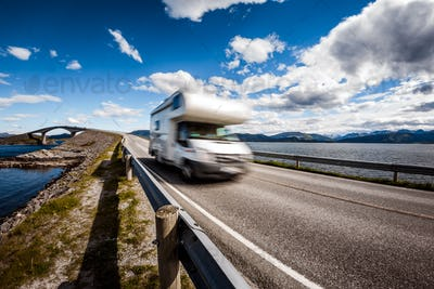 Caravan car RV travels on the highway Atlantic Ocean Road Norway
