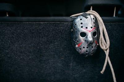 Hockey mask, rope, murderer concept