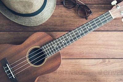 Ukulele guitar on wooden table