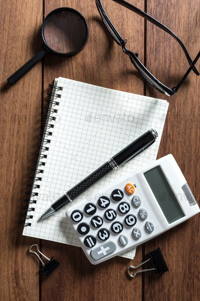 Empty notebook with calculator on desk office