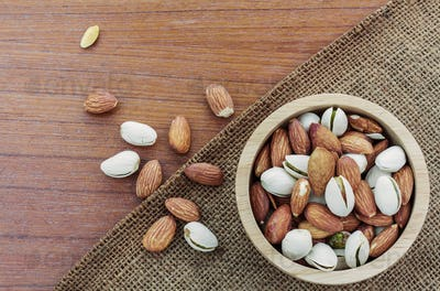 Almonds in bowls on sacks