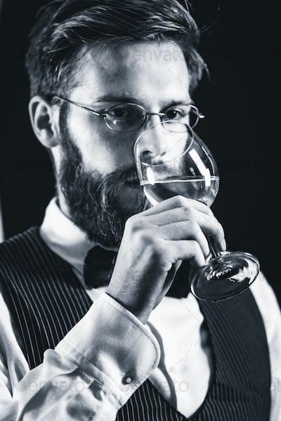 Sommelier tasting white wine