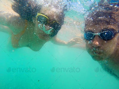 Couple snorkeling in the sea, underwater view