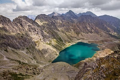 Beautiful lake Hlincovo Pleso among rocky Tatra mountains