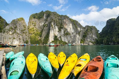 Colourful kayaks with limestone mountains background