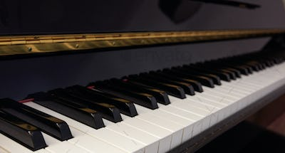 Piano keyboard, low angle, selective focus