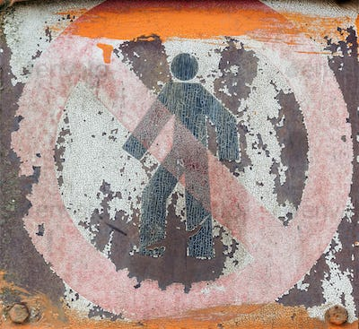 Faded and shabby sign of danger on a metal plate