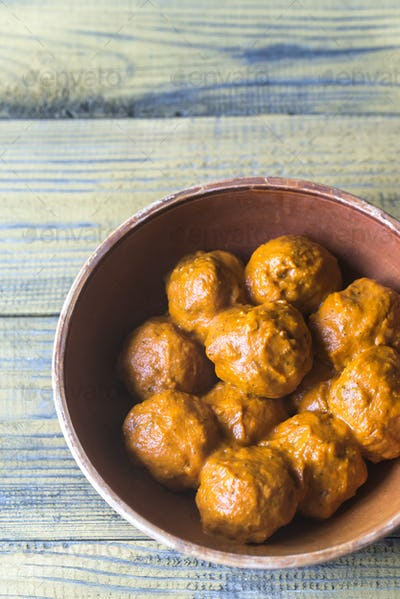 Bowl of turkey meatballs with curry sauce