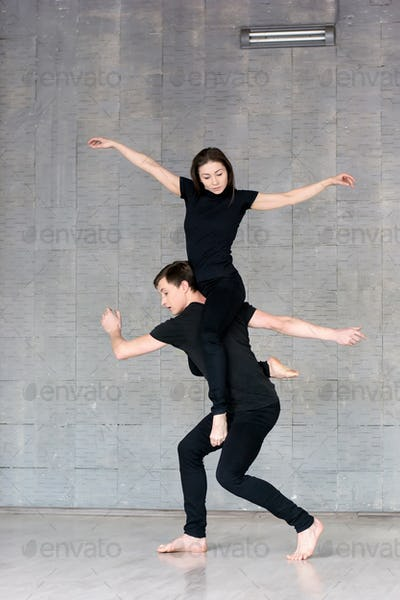 Couple of dancers in dynamic position
