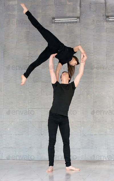 Talented couple practising modern dance