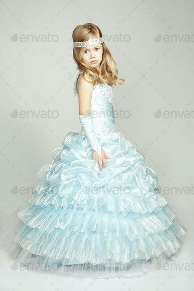 Portrait of little girl in luxurious dress