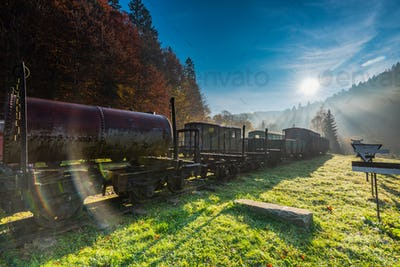 Sun rays and flare at misty morning in abandoned railway station