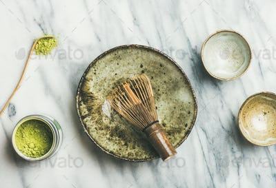 Japanese tools and bowls for brewing matcha tea, top view