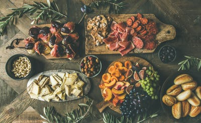 Flat-lay of holiday, party, family dinner table set with snacks
