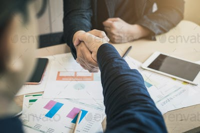 Two Businessmen shaking hand Agreement Partnership