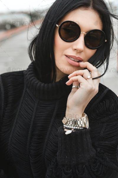 Young woman wearing woolen sweater