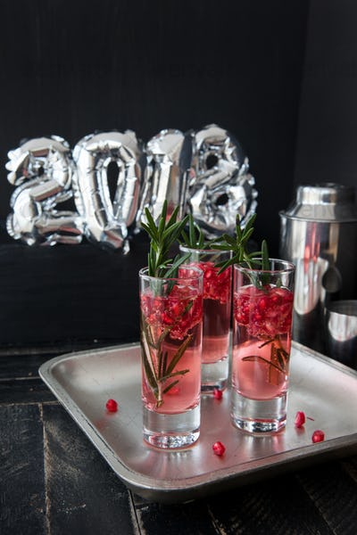 Cocktail with pomegranate and rosemary