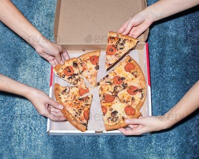 hands near pizza box