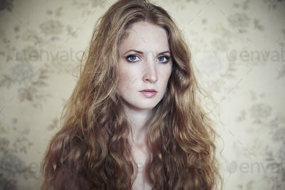 Photo of young beautiful woman with red curly hair