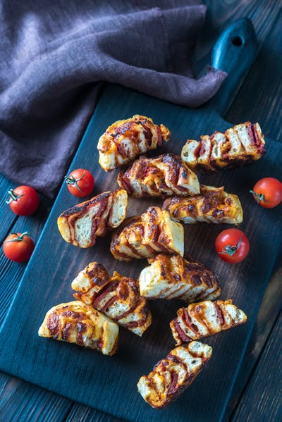 Pizza rolls on the wooden board