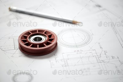 Plastic wheel bearing on blueprint