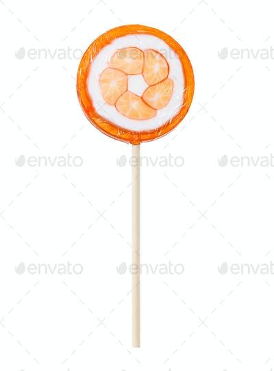 Orange lollipop isolated on white