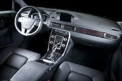 Car dashboard, modern luxury interior, steering wheel
