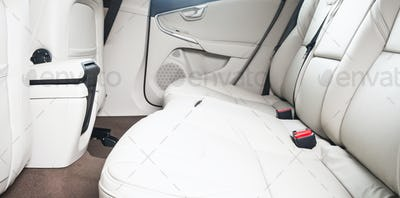 back seats of modern luxury car, white leather interior