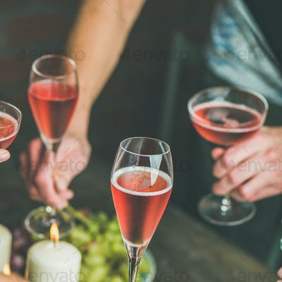 People having party, gathering, celebrating with rose champaign, square crop