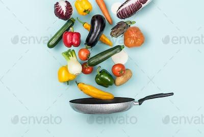 Fresh healthy vegetables falling in a pan