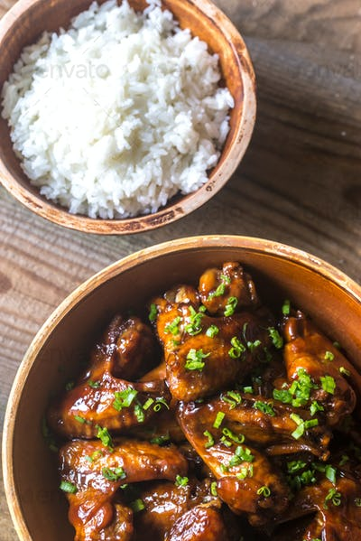 Bowl of teriyaki chicken wings with rice