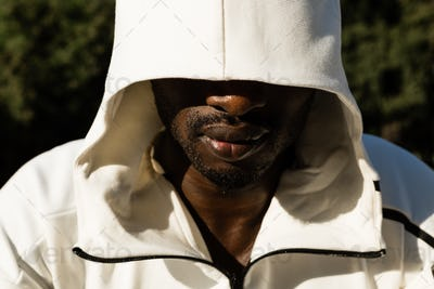 Portrait of a black man in a city park