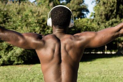 Athletic black man listening to music