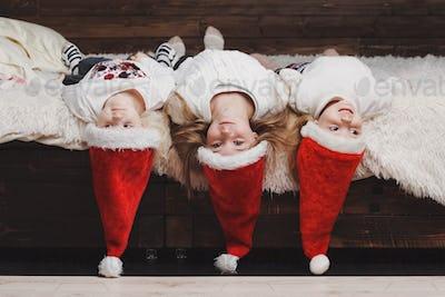 cute happy children with santa hats