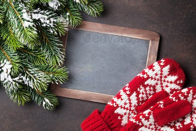 Christmas fir tree, mittens and chalkboard for your greetings