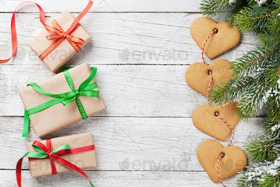Christmas gift boxes, fir tree and cookies