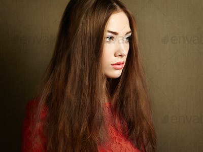 Portrait of beautiful dark-haired woman close up.