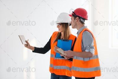 Engineers examining tiles