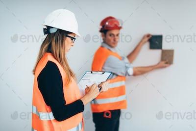 Architects examining tiles